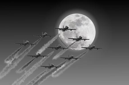 aeronautics: Acrobatic air patrol flying on the moonlight Stock Photo