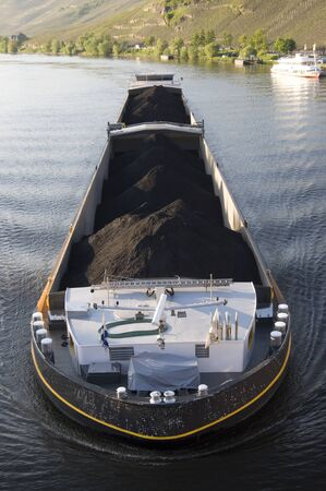 barge: A barge carrying coal along the Moselle in Germany