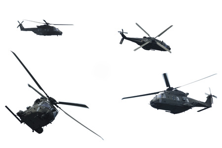 A helicopter in flight during a military demonstration photo