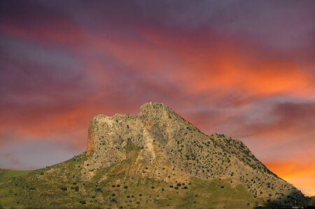 ch: This rocky mountain east of the town of Antequera is known as the Mount of Love from a very ancient legend. A Muslim prince in love with a beautiful Christian girl unleashed the wrath of his father, as such love was forbidden. The two lovers fled, but, ch Stock Photo