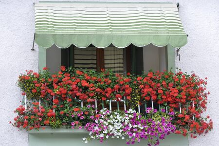 Balcony with flowers in a small Italian town