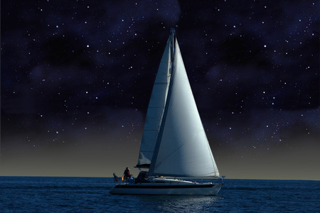 A sailboat sails under the starry sky