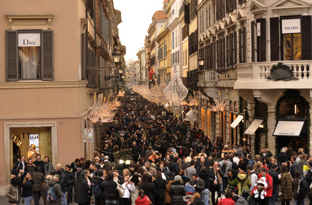 A large crowd of people invaded the streets of Rome during the Christmas shopping. Via Condotti is particularly crowded.