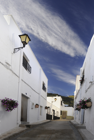 andalusian: Alley of Andalusian village under the blue sky