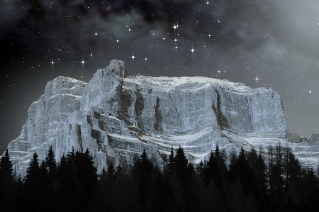 astrophoto: View of the Dolomites on a starry night in winter Stock Photo