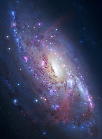Galaxy M106 lies 23.5 million light-years away, in the constellation Canes Venatici.
