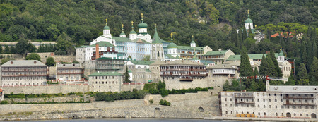 to and fro: View fro the sea of Russian moastery at mount Athos Greece Stock Photo