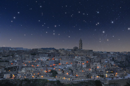 sassi: Panoramic view of Matera, in Italy, under starry sky