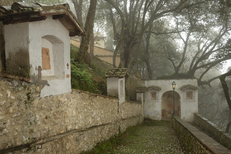 Via Crucis walk path to the Sacro Speco grotto where Saint Francis prayed, at the Santuary of Fonte Colombo near Rieti, Italy Stock Photo