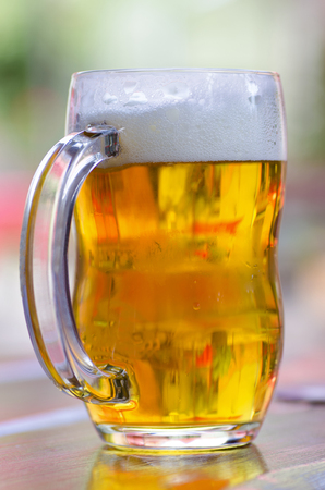 brewery: Close-up view of a glass of beer with foam Stock Photo