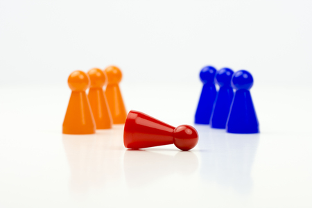 Close-up photo of a group of different-colored pieces in different positions on a white background - applicable to the team view Stock Photo