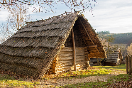 Old rural hut with a thatched roof made of straw