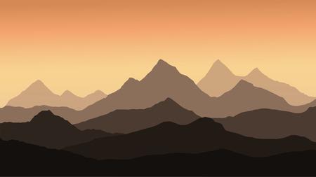 vue panoramique sur le paysage de montagne avec le brouillard dans la vallée ci-dessous avec le ciel orange