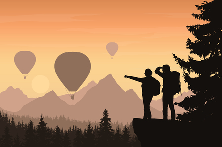 Two hikers looking down into the valley between mountains with forest and flying hot air balloons - vector
