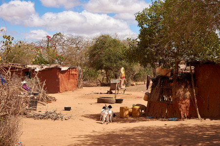 View of an old masai village with huts of clay. Poverty and misery in Kenya in Africa