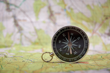 Detailed view of compass and tourist map with defocused background and space for text 写真素材