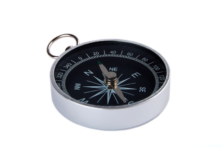 Detailed view of a magnetic compass silver and black color, isolated on white background.
