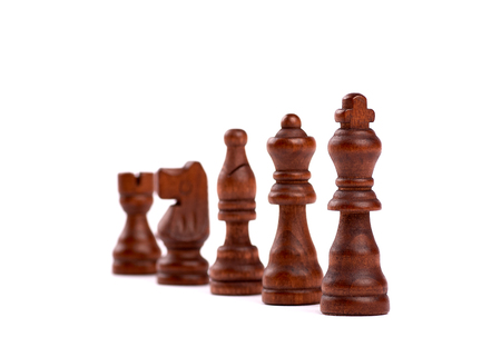 Row of black wooden chess pieces. Team Hierarchy With Defocused Background - Isolated On White Background. Banque d'images - 125369179