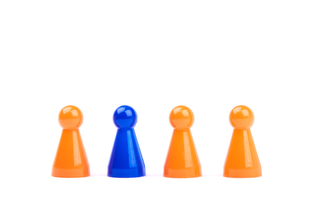 A series of orange game pieces and one different and exceptional blue figure as leader or boss - isolated on a white background Banque d'images - 125369214