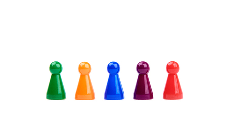 Five plastic toys - playing pieces with different colors as diverse team standing in a row - isolated on white background Banque d'images - 125369216