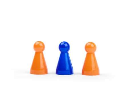 Three playing plastic figures. Two orange and one different blue figurine, isolated on white background. Banque d'images - 127503783
