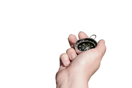 Female hand holding fingers compass pointing north. Isolated on white background Banque d'images - 127504492