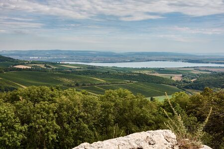 Landscape view of Palava in South Moravia. Lake Nove Mlyny and towns Pavlov and Klentnice under blue sky with clouds