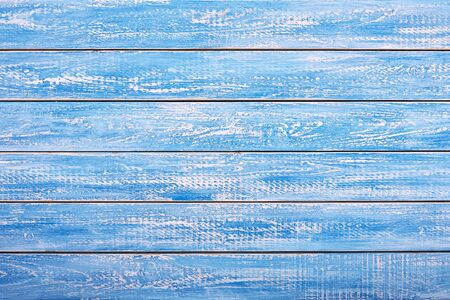 Realistic wooden background or table top in white and blue colors. Scuffed and scratched the surface.