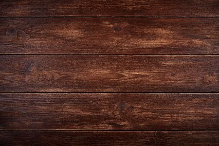 Realistic wooden background or natural brown color table top. Old scuffed and scratched surface.