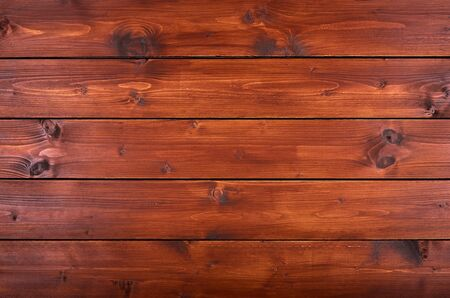 Realistic painted wooden background or table top in natural brown color. Surface with boards