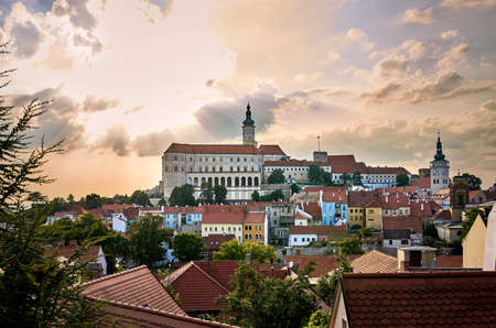 A view of the town of Mikulov in southern Moravia in the Czech Republic. A tourist destination under a dramatic sky with the sunset. Banque d'images