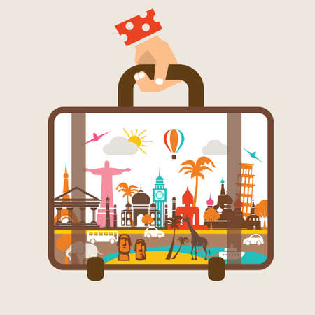 hand holding luggage, travel around the world concept