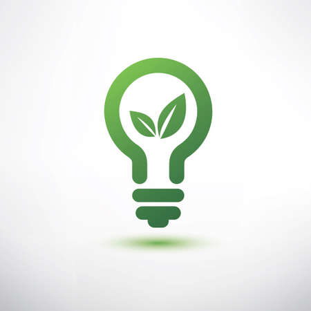 green eco energy concept, plant growing inside the green light bulb