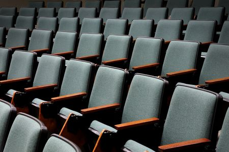 occupancy: Rows of unoccupied seats in an empty auditorium or lecture hall Stock Photo