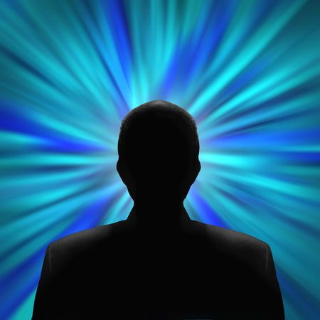 Black silhouette of a mysterious man in front of a blue vortex Stock Photo