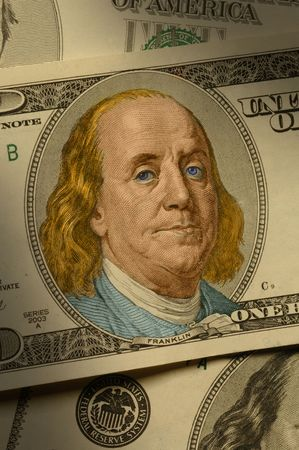 franklin: Close-up of Benjamin Franklin on the $100 bill, dramatically lit and hand-colored. Stock Photo