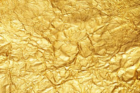 Crumpled gold foil textured background Horizontal photo