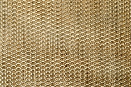 wire mesh: Air filter grill dramatically lit. Horizontal