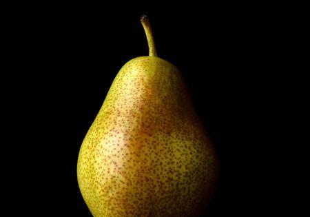 pomme: Barlett pear against black background Stock Photo