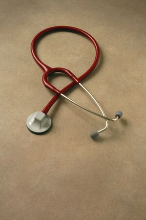 Red stethoscope on a table
