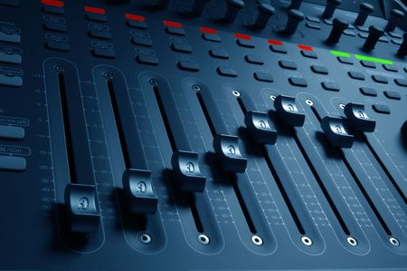 Close-up of audio mixing board sliders photo
