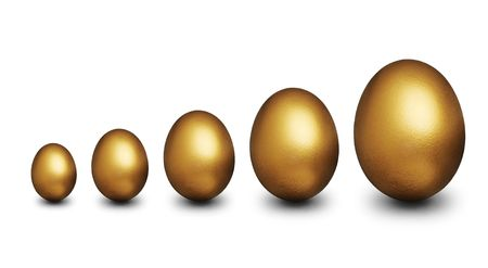 Five golden egg of various sizes representing financial security against a white background