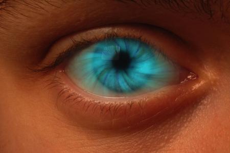 Close-up of eyeball with a blue vortex