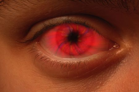 psychic: Close-up of eyeball with a red vortex Stock Photo
