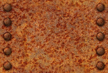 Rusted metal surface with rivet bolts seamlessly tileable
