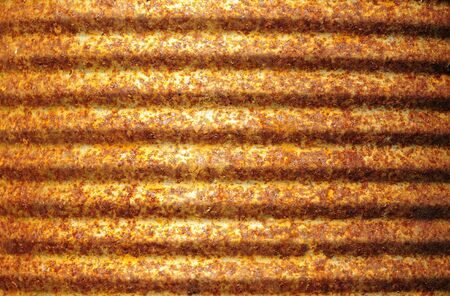Closeup of rusty corrugated metal can surface