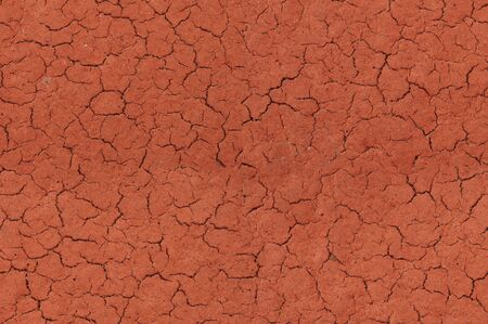 Cracked red textured surface background, seamlessly tileable Stock Photo