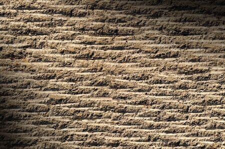 grooved: Grooved asphalt or rock surface texture  lit diagonally