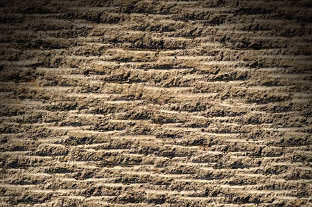 grooved: Grooved asphalt or rock surface texture lit from above