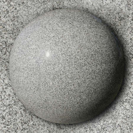 polished granite: Stone sphere against polished granite surface
